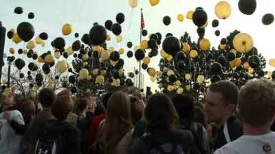 Cherry Creek H.S. students release balloons to support Arapahoe H.S. and Claire Davis