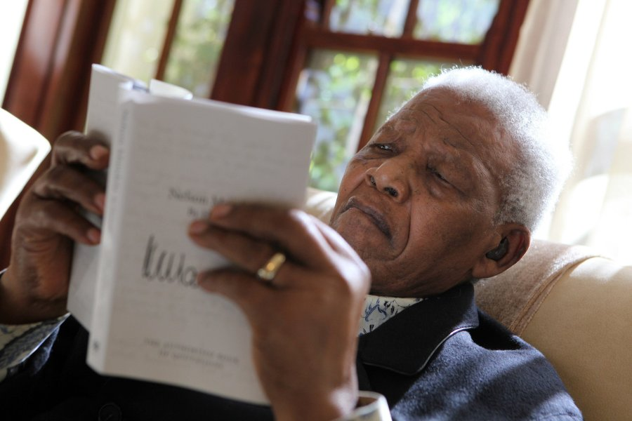 """Nelson Mandela reads an advanced copy of his new book Nelson""""""""Mandela by himself"""" the authorized quotation book. The book was launched Monday, June 27 2011 at the Nelson Mandela Foundation in Houghton, Johannesburg. Byline: Debbie Yazbek/Nelson Mandela Foundation"""