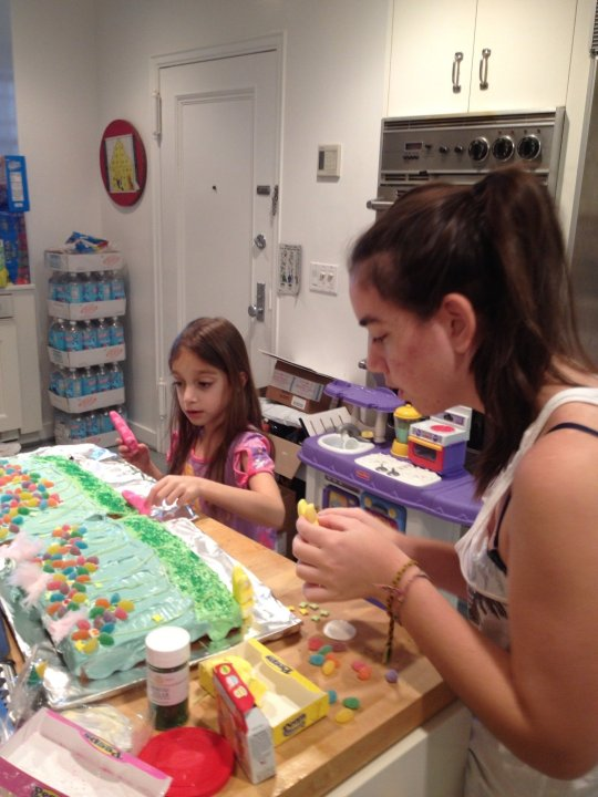 """Katie Danziger, founder of Nomie Baby, which offers unique car seat covers among other products, heads to the kitchen to lower stress for her daughters, age 18 and 7 (pictured here). """"Baking is always a good one, and then the benefits of the great smells from the oven reinforce the ahhhh,"""" the New York mom of three said."""