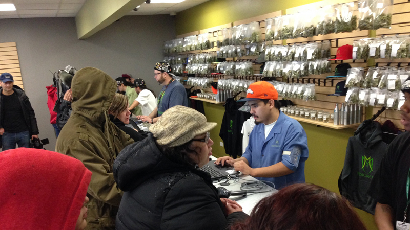 Over 40 people wait in line to buy recreational marijuana at Evergreen Apothecary in Denver, Colorado on January 1, 2014.