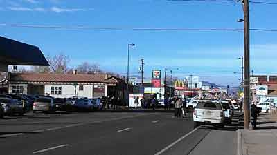 Police respond to a hostage standoff at 7-Eleven, Colfax and Perry in Denver