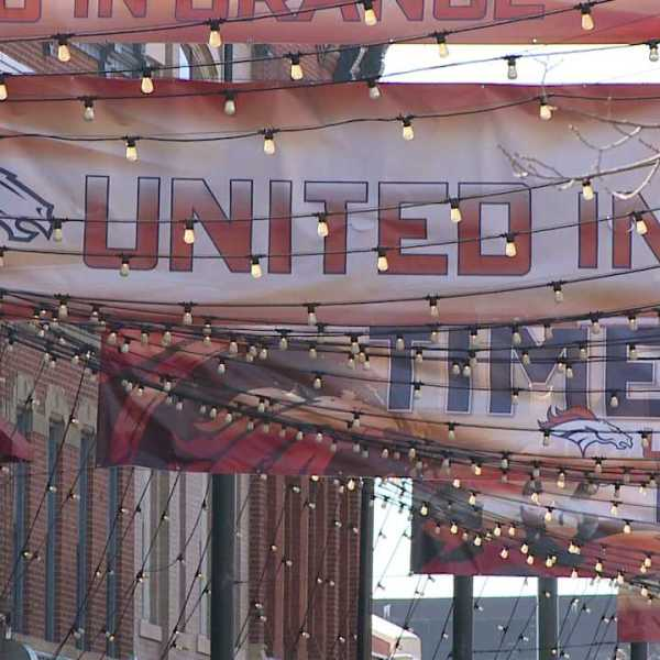 United in Orange signs hang in Larimer Square the day after the Super Bowl