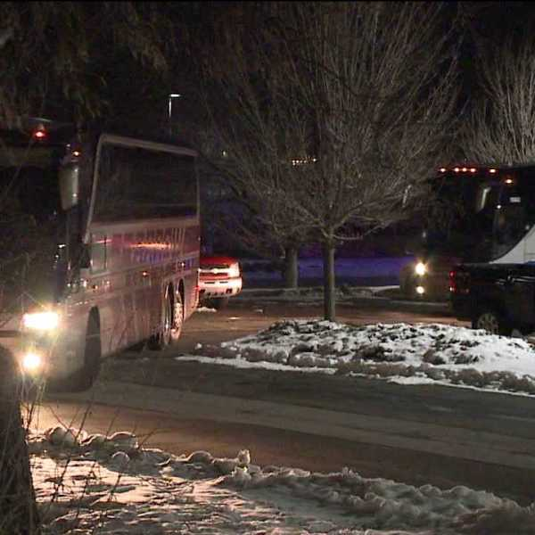Buses carrying the Denver Broncos return to Dove Valley