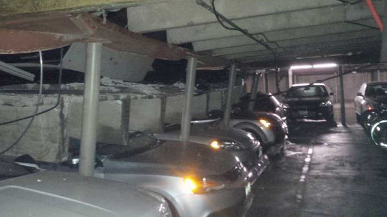 5 cars crushed in partial collapse of parking garage