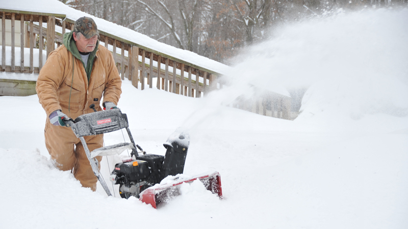 David Cavell, Sr. uses a snowblower to dig out after a winter storm dropped over a foot of snow on the Washington, DC area. Credit: Aaron Skolnik/FEMA