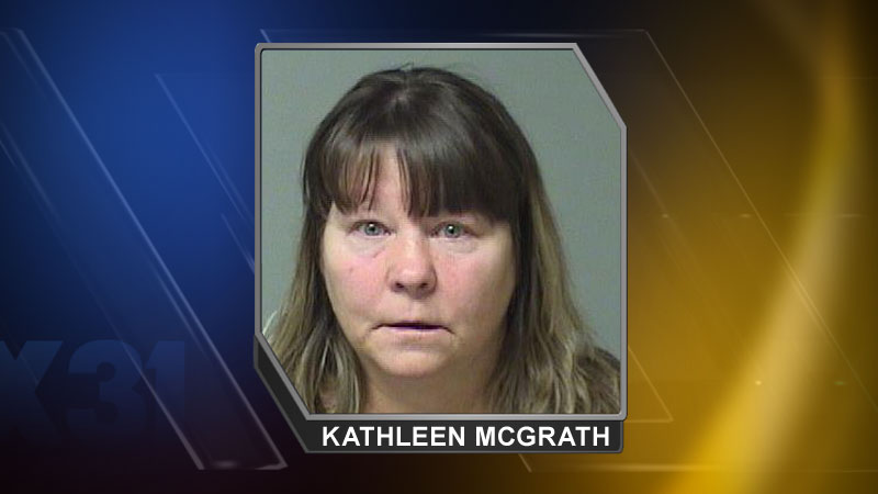 Kathleen McGrath was arrested on March 13, 2014 and charged with theft from a booster club. (Photo: First Judicial District Attorney's Office)