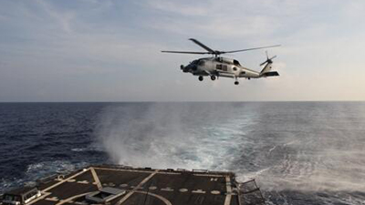 US Navy SH-60R Seahawk departs to aid in the search efforts of the missing airliner. MH370 Malaysia Airlines. Photo: US Nave/U.S. 7th Fleet