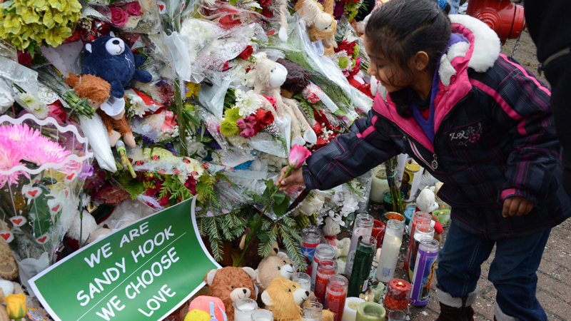 A makeshift memorial lies along the main road to leading to Sandy Hook Elementary school in Newtown, Connecticut. Dec. 2012. Photo credit: Mike M. Ahlers/CNN