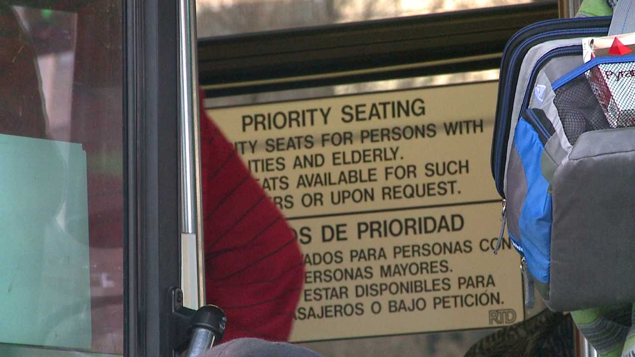 Sign explains seating policy on RTD bus in Denver
