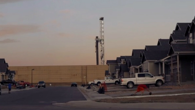 An image of a fracking well being drilled just a few hundred feet from a row of homes in northern Colorado, as depicted in the first TV ad from Coloradans for Local Control, the group pushing a ballot measure to allow cities to ban fracking.