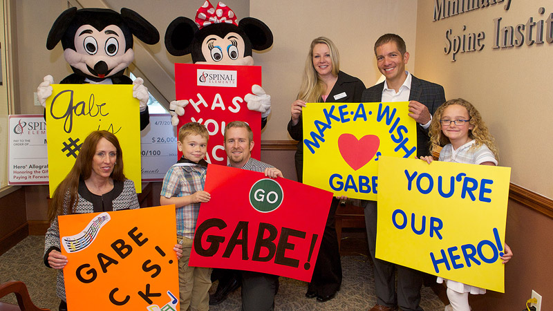 Mickey and Minnie Mouse presented 6-year-old Gabe Daggett with his Make-A-Wish dream trip to Disney World. (Photo: Courtesy Spinal Elements)