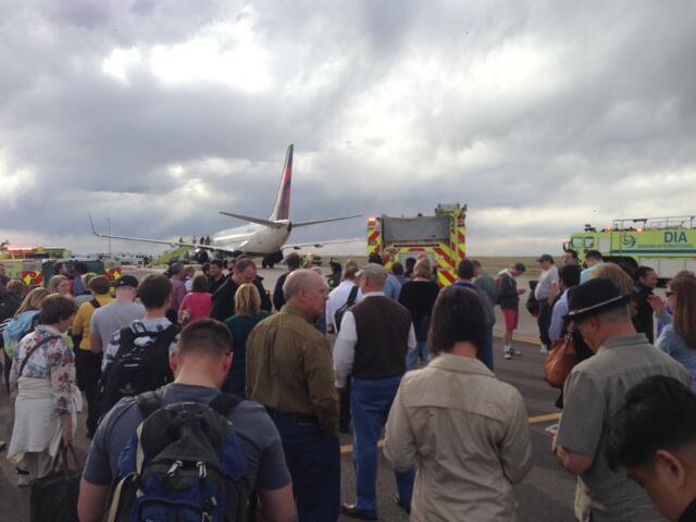 Scene at Delta flight with security threat at Denver International Airport. Photo courtesy: Jon Lamp