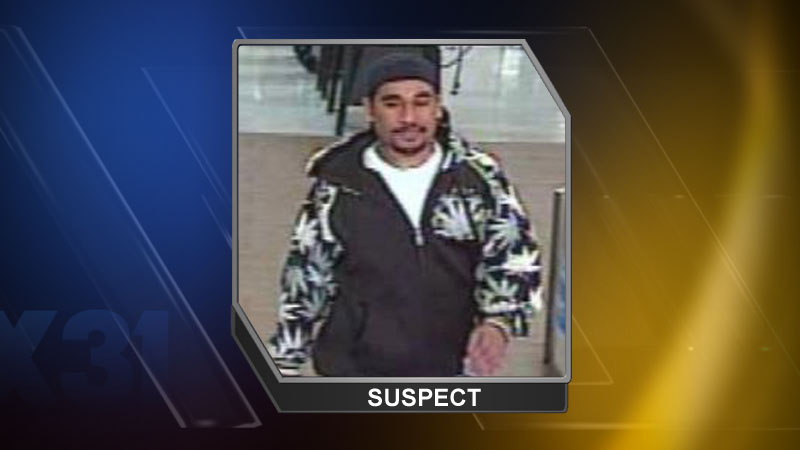 Police are searching for a man who looked under the bathroom stall in a women's restroom on April 28, 2014. (Photo: Denver Police Department)