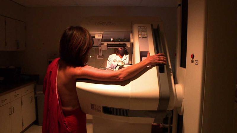 A patient gets a mammogram.