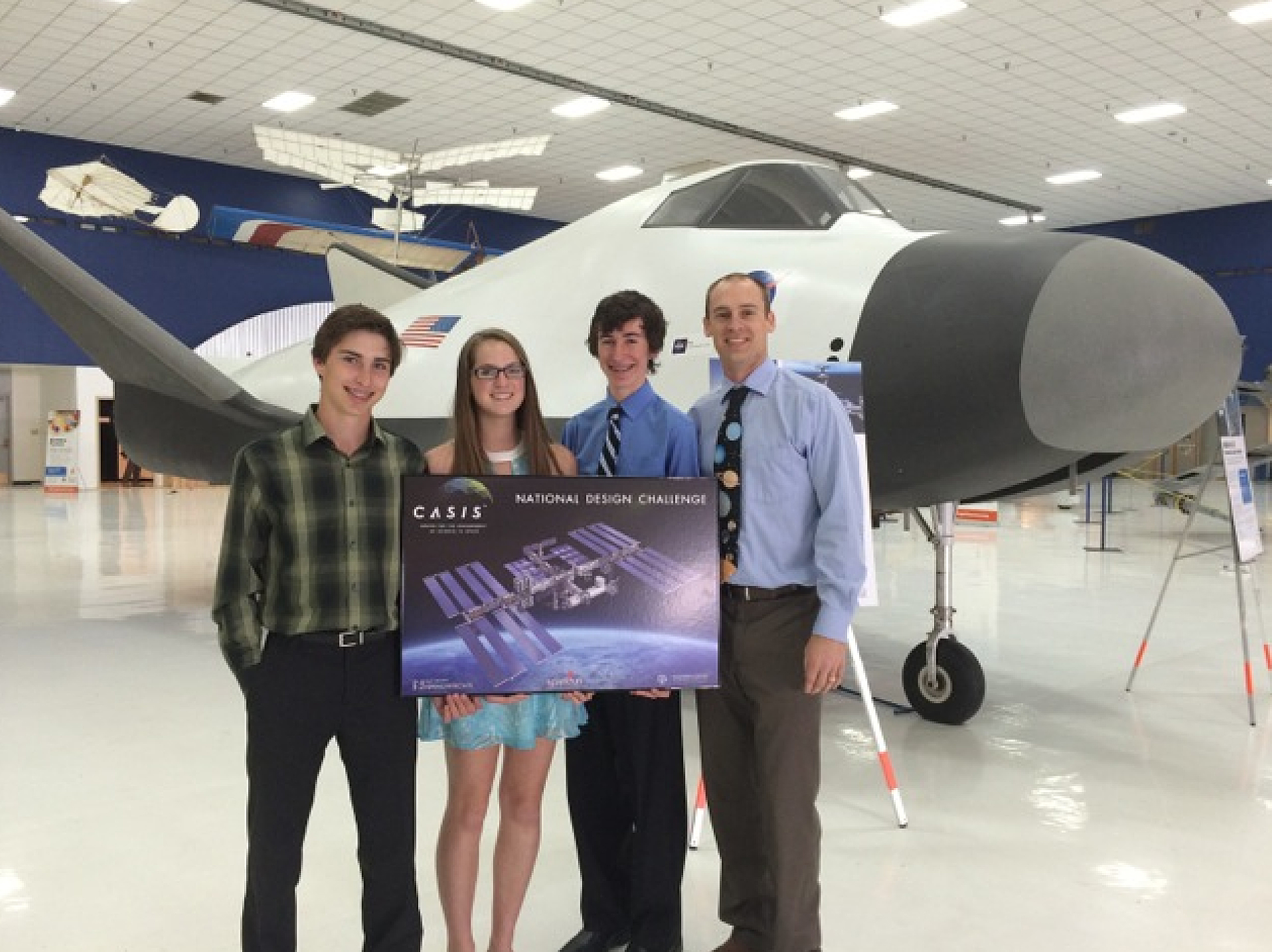 Centaurus Engineering students Jack Carvalho, Abby Schmid and Bryan McCarty with teacher Brian Thomas at the National Design Challenge Conference held in Denver on May 8-9.
