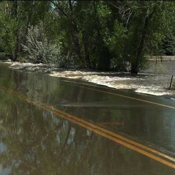 River floods a road in Greeley, Colo.
