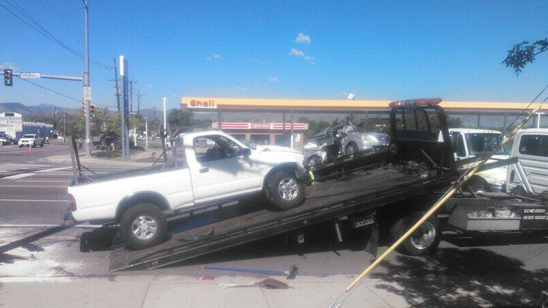 Witnesses said the white truck on the tow bed ran a red light, causing the six-vehicle accident in Wheat Ridge on May 28, 2014. (Photo: KDVR/Joshua Hans)