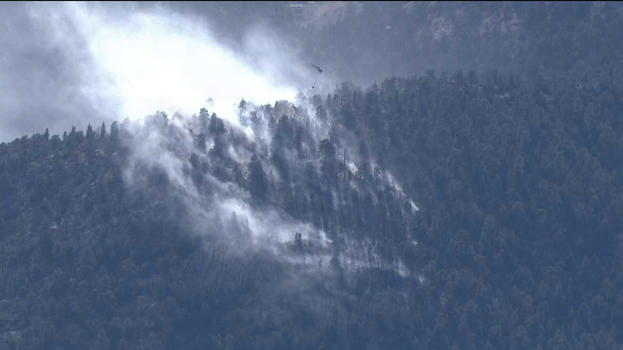 A light helicopter works on the Granite Gulch Fire in Larimer County, Colo.