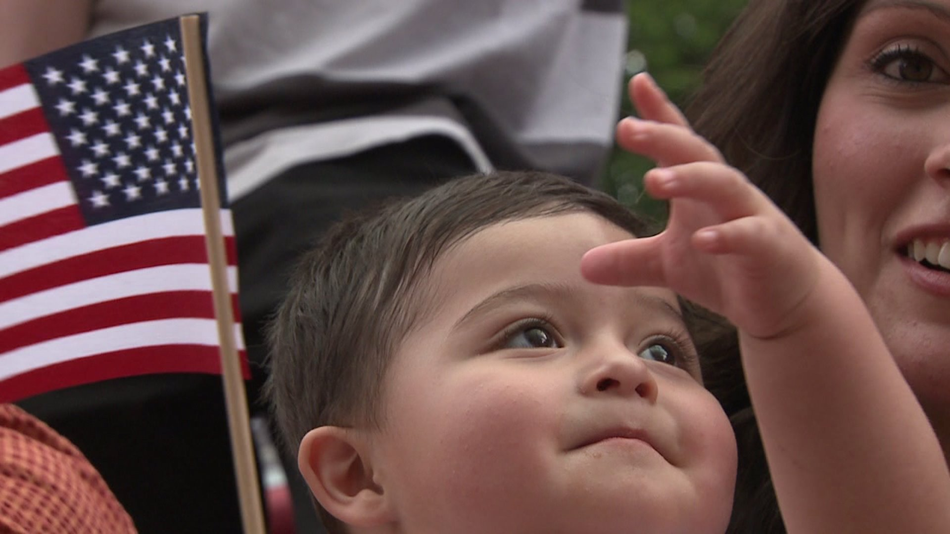 A child waves his flag at the Park Hill 4th of July Parade in Denver