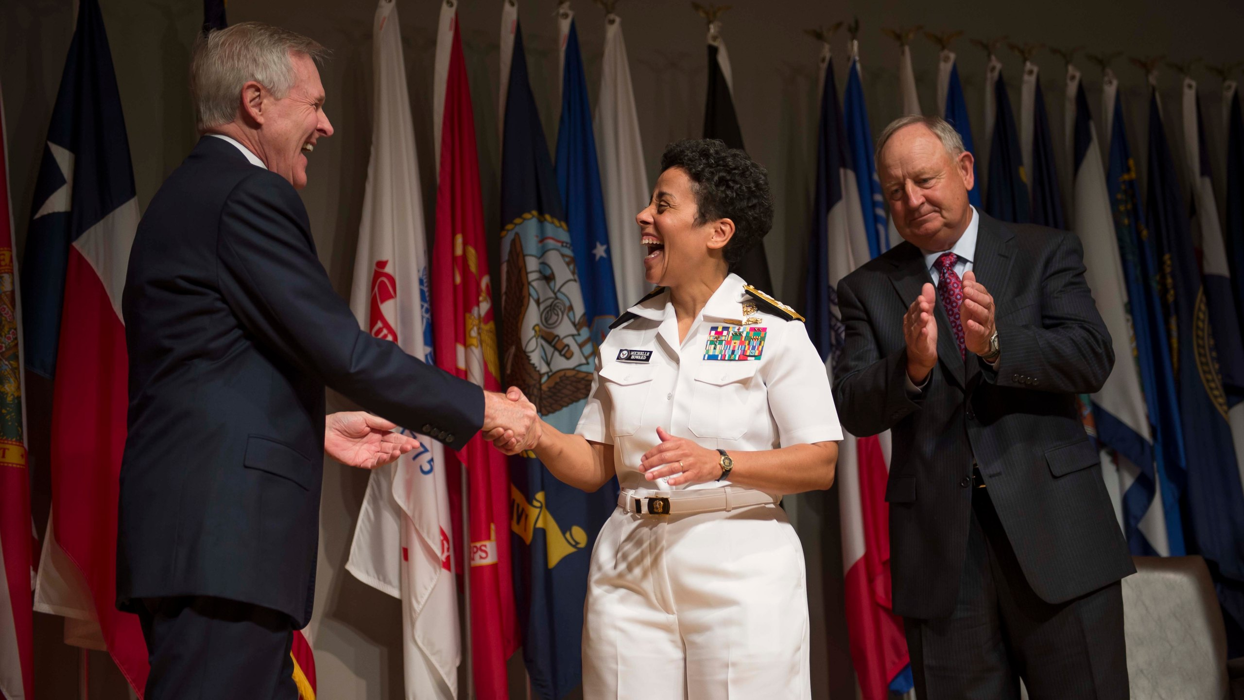 Secretary of the Navy Ray Mabus congratulates Adm. Michelle Howard after putting on her fourth star during her promotion ceremony at the Women in Military Service for America Memorial. Photo: Peter D. Lawlor/U.S. Navy
