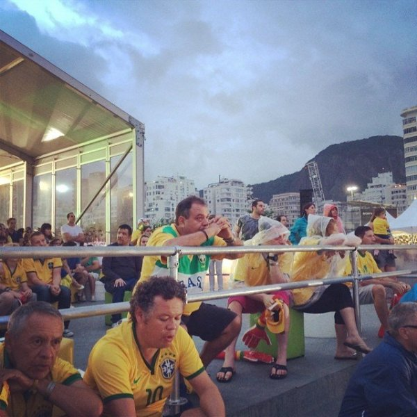 Devastated Brazil fans take a moment after Germany pummeled their team 7-1 Tuesday, July 8, 2014.