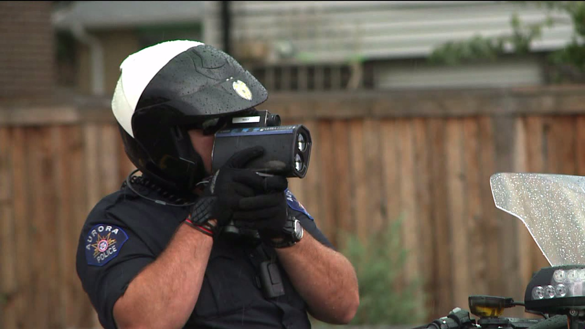 Aurora police officer checking speed with a radar gun
