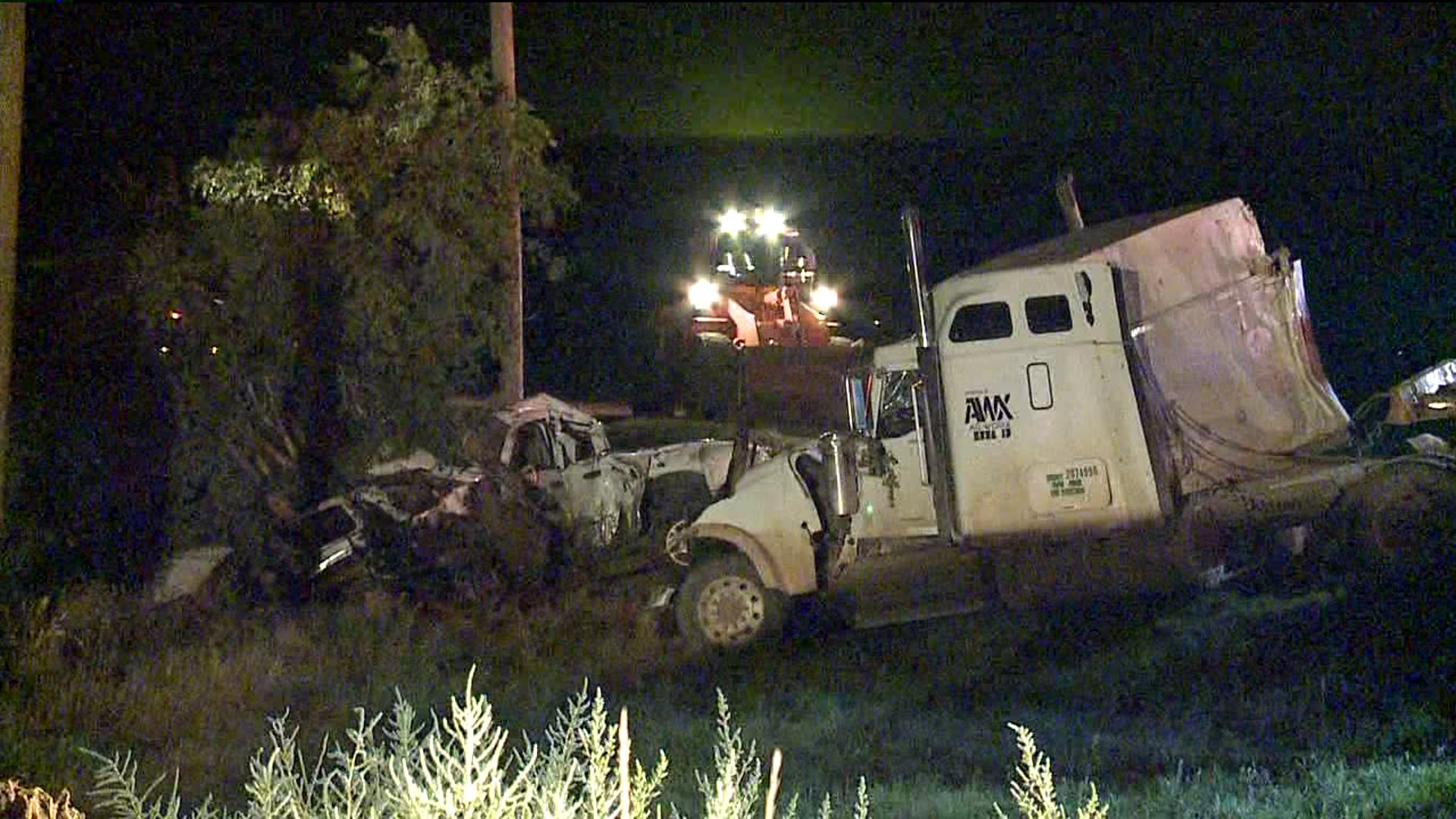 Deadly crash between semi hauling logs and pickup truck in west of Ault in Weld County, Colo.