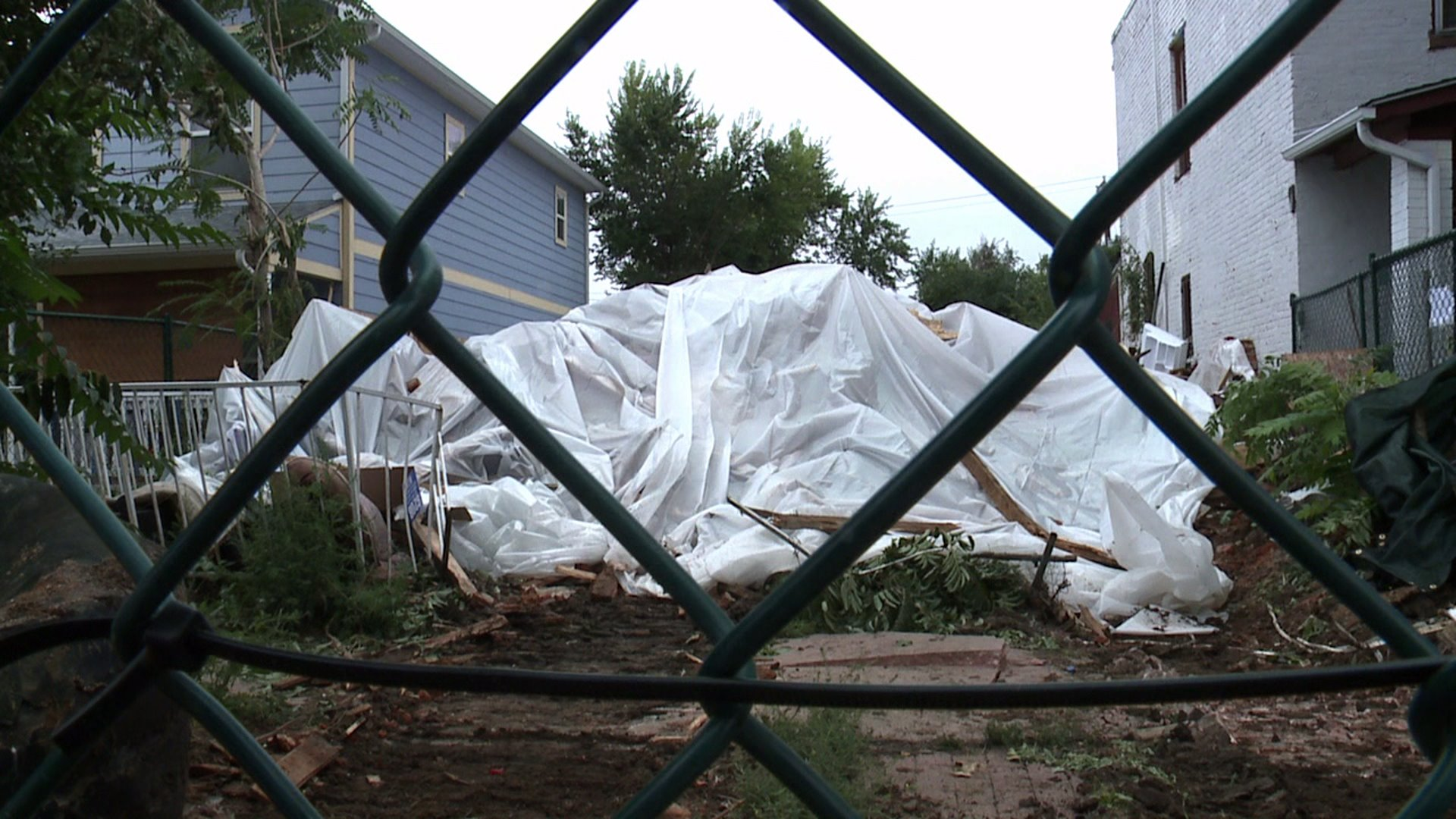 Rubble is all that's left of house that had wall collapse at 12th and Kalamath in Denver