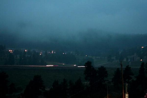 Rain and fog along I-70 in Genesee west of Denver. Photo: Daryl Orr