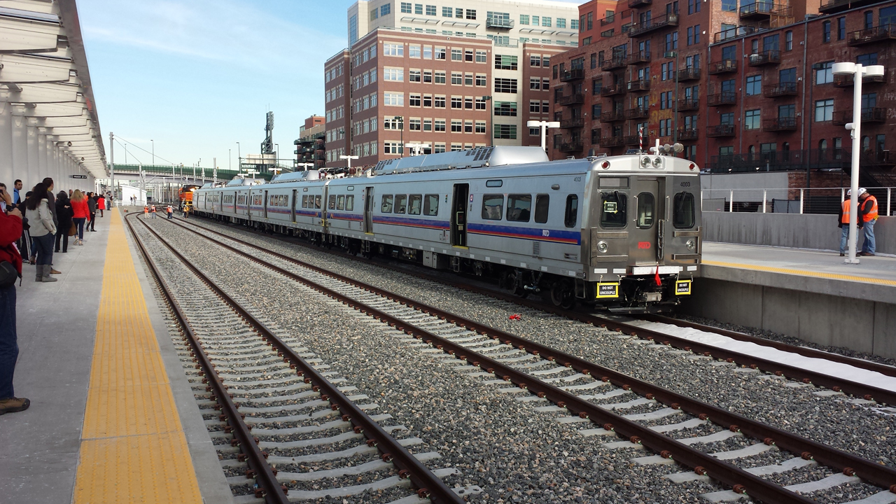 Commuter rail cars arrive at Denver Union Station