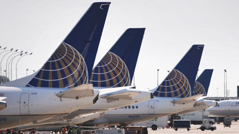 United Airlines jets sit at gates at O'Hare International Airport. (Photo: Scott Olson/Getty Images)