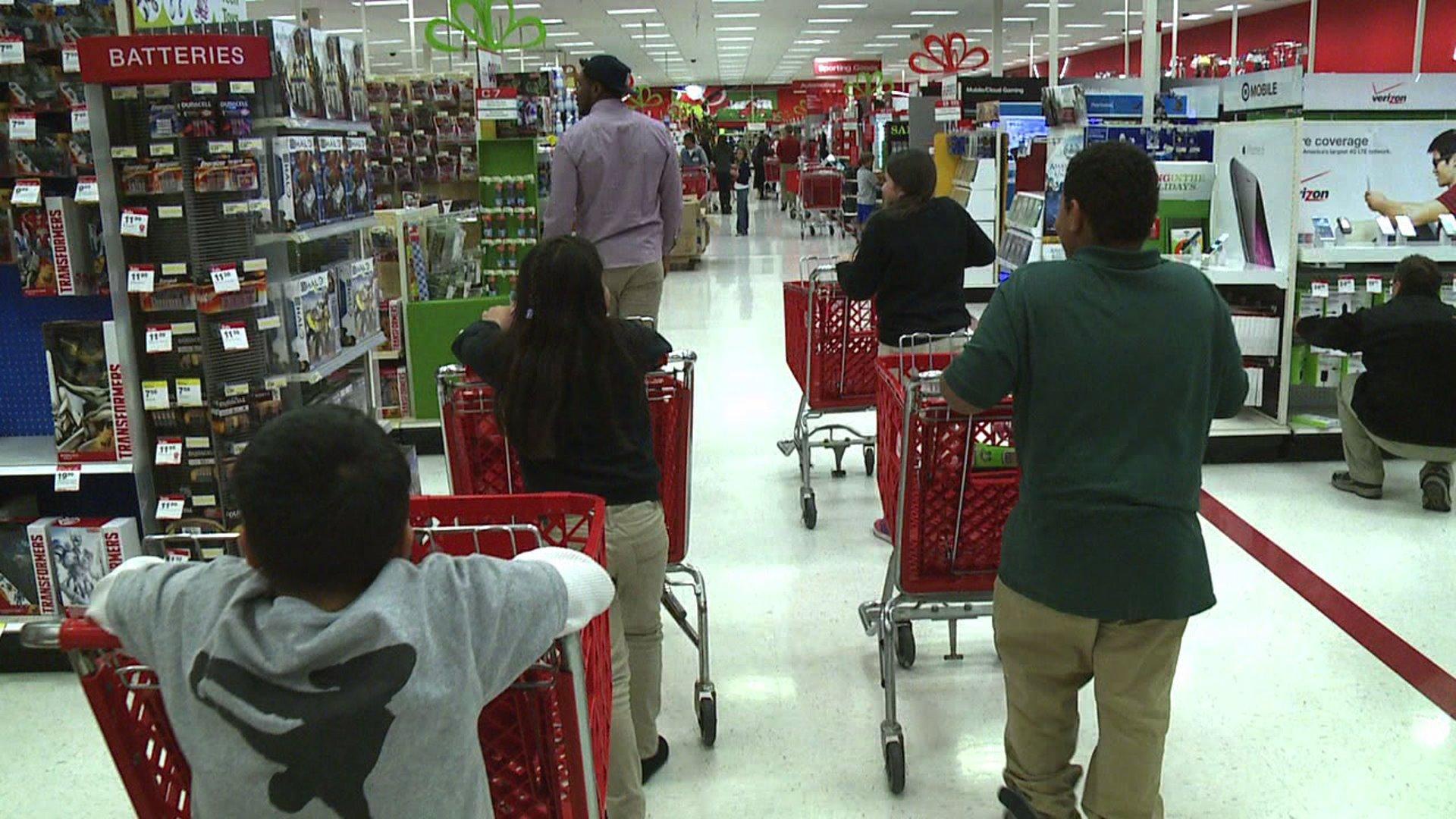 Broncos players like Julius Thomas take kids shopping for presents