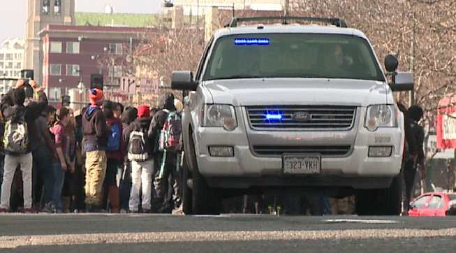 Protesters stopped to watch as the four officers paramedics treated the four officers.