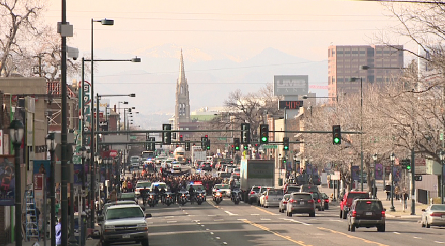 Students walked down Colfax Avenue headed back to East High School