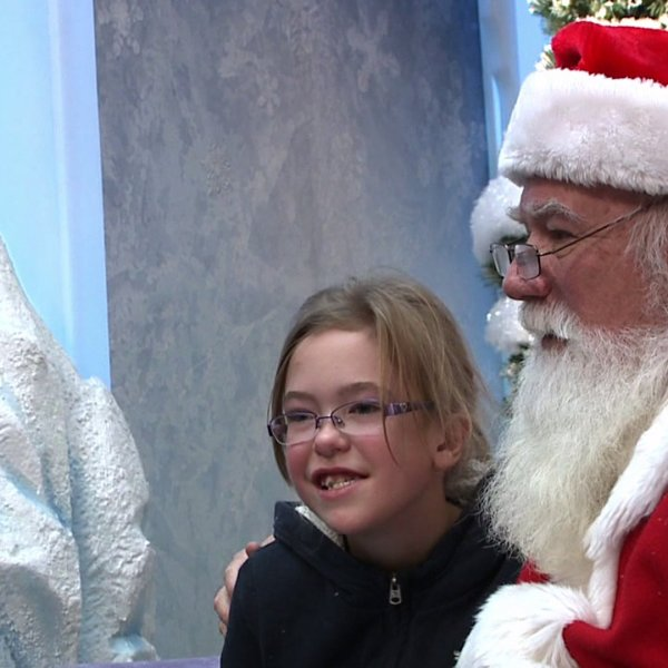 Signing Santa meets with hearing impaired children