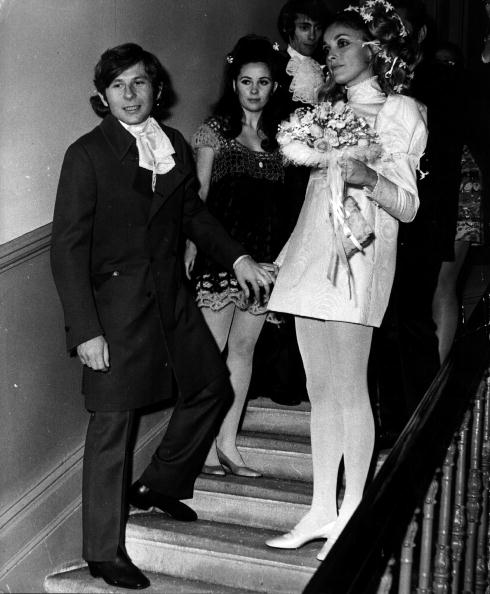 American film actress Sharon Tate (1943 - 1969) (right) with Polish film director Roman Polanski, after their wedding in London. (Photo by Keystone/Getty Images)