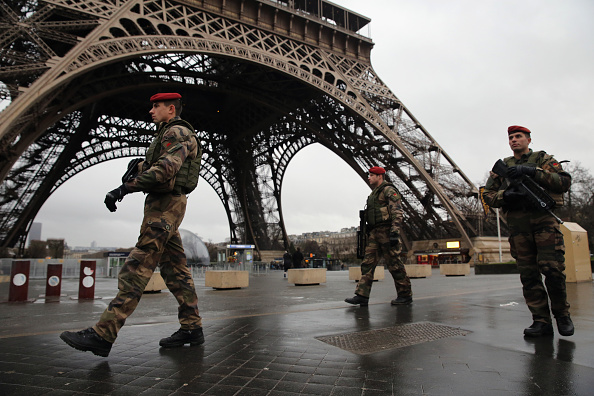 Armed security patrols around the Eiffel Tower on January 9, 2015 in Paris, France. A huge manhunt for the two suspected gunmen in Wednesday's deadly attack on Charlie Hebdo magazine has entered its third day. (Photo by Dan Kitwood/Getty Images)