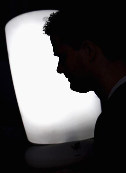 Silhouette of sad man.