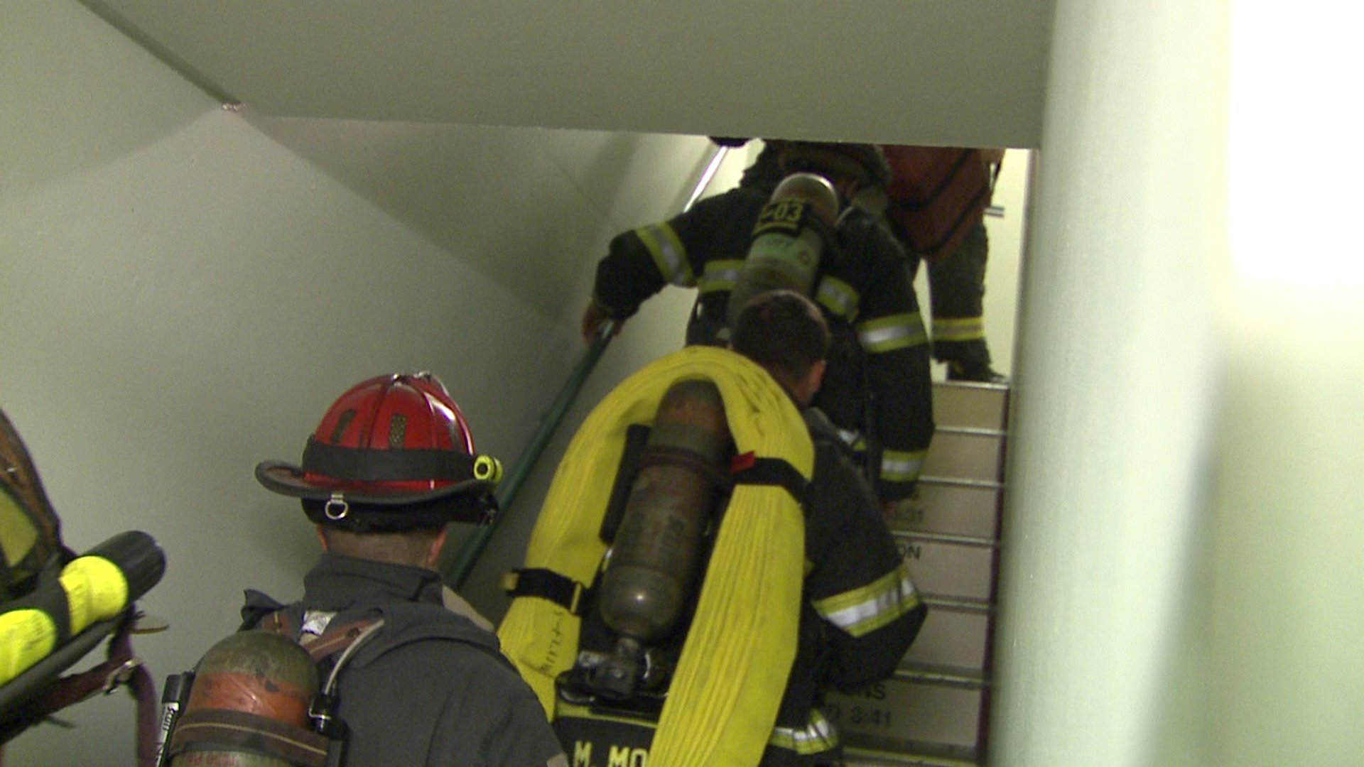 Firefighter recruits climb to top of Denver skyscraper as part of their training