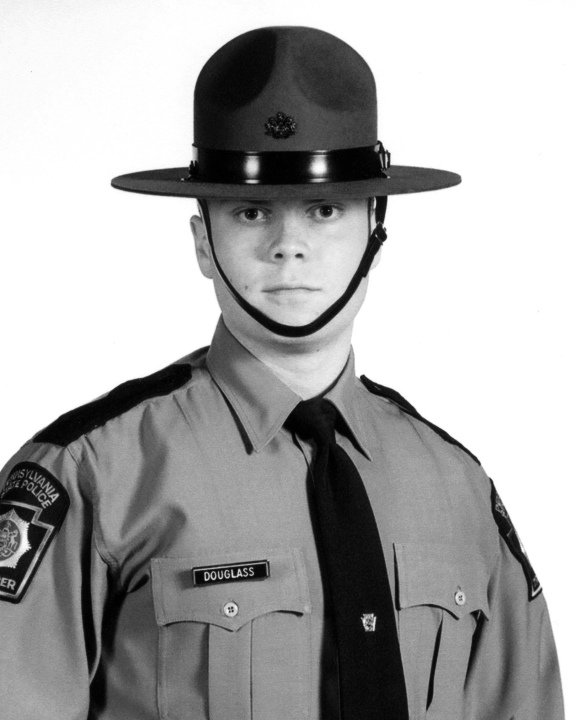 Two Pennsylvania State Police troopers were shot late Friday, Sept. 12, 2014 outside the police barracks in Blooming Grove, Pennsylvania. Cpl. Bryon K. Dickson was killed and Trooper Alex T. Douglass (shown) was in stable but critical condition on Sunday evening.
