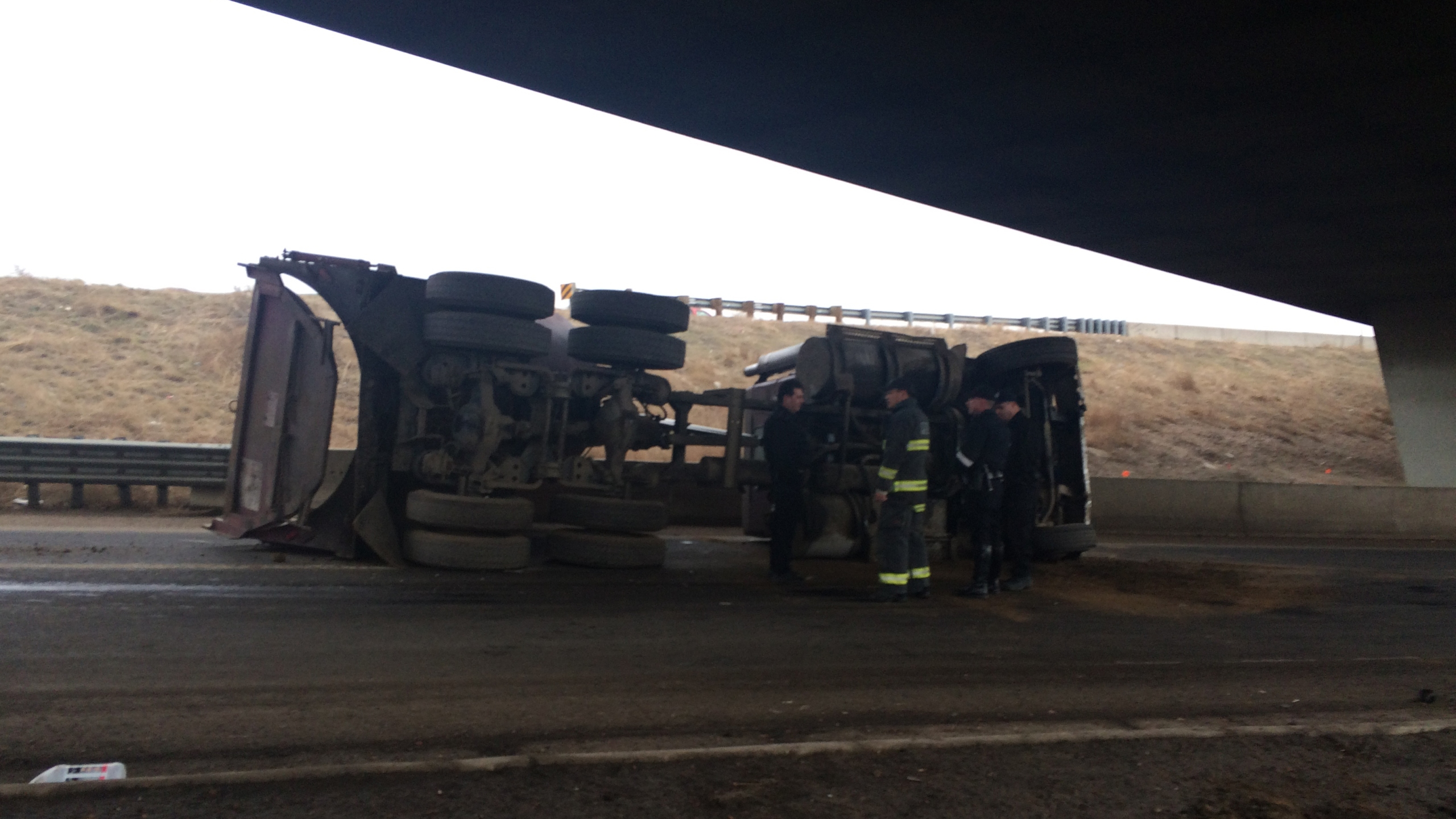Truck rollover closes 8th Ave. off-ramp from northbound I-25. January 13, 2015