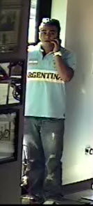 Suspect #3: Hispanic male with short dark hair, wearing a blue and white polo with the word Argentina printed on the front, and blue jeans.