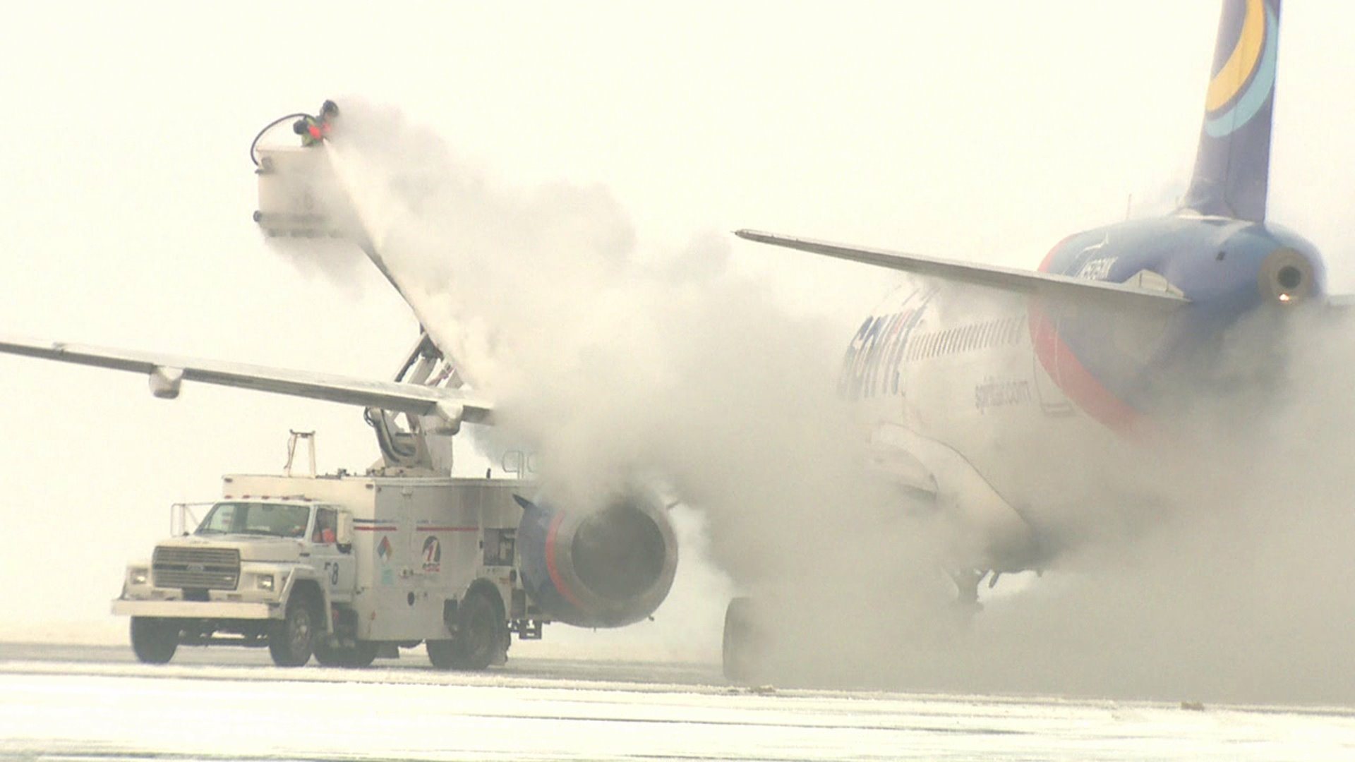 Deicing a jet at Denver International Airport