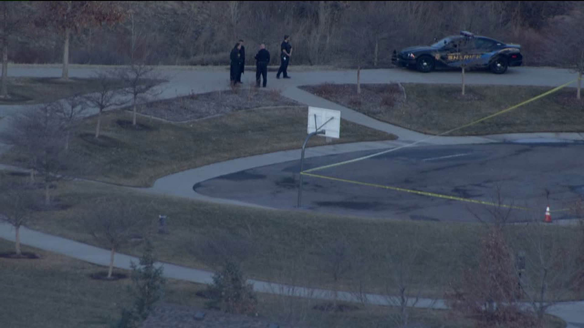 Investigators in Dad Clark Park in Highlands Ranch, Colo