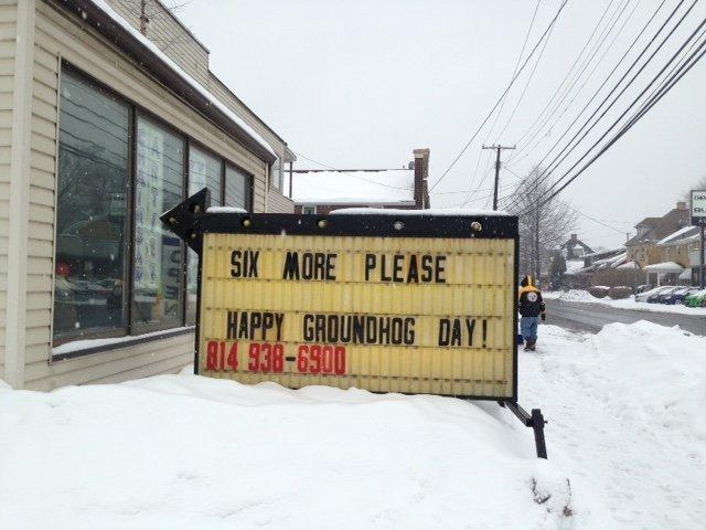 Sign welcoming six more weeks of winner in Punxsutawney, Pennsylvania
