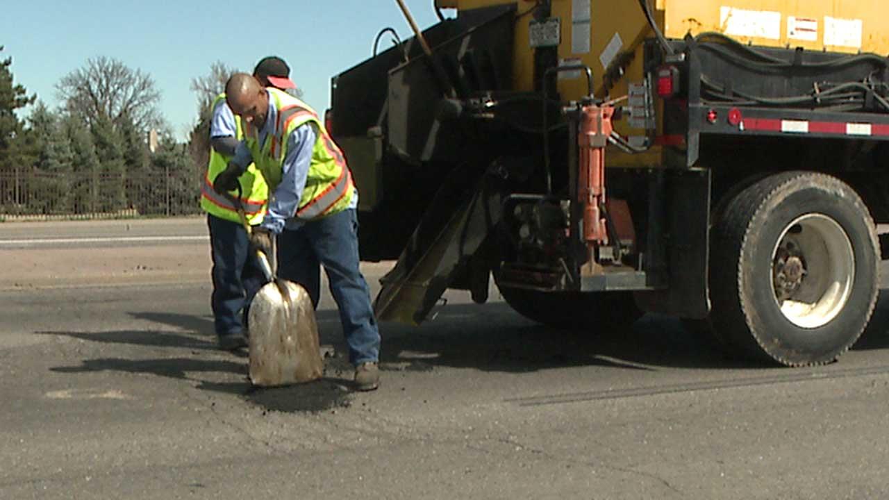 Filling potholes in Aurora, Colo