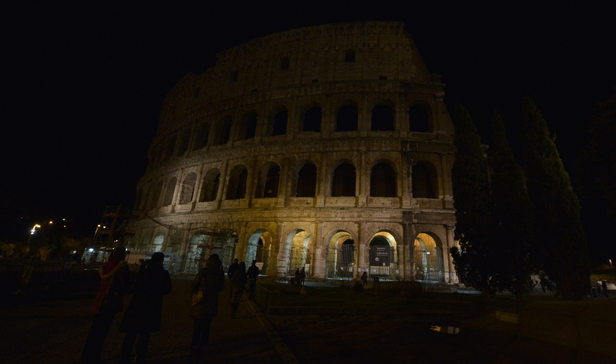 A picture taken on March 28, 2015 in Rome shows Colosseum before being submerged into darkness for the Earth Hour environmental campaign. Millions are expected to take part around the world in the annual event organised by conservation group WWF, with hundreds of well-known sights set to plunge into darkness. AFP PHOTO / TIZIANA FABI (Photo credit should read TIZIANA FABI/AFP/Getty Images)