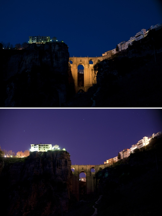 """A combination of two pictures shows the New Bridge of Ronda illuminated (Top) and after the lights were turned off during the global climate change awareness campaign """"Earth Hour"""", on March 28, 2015. Millions are expected to take part around the world in the annual event organised by environment conservation group WWF, with hundreds of well-known sights including the Eiffel Tower in Paris and the Seattle Space Needle set to plunge into darkness for an hour to highlight the plight of the planet. AFP PHOTO/ JORGE GUERRERO (Photo credit should read Jorge Guerrero/AFP/Getty Images)"""