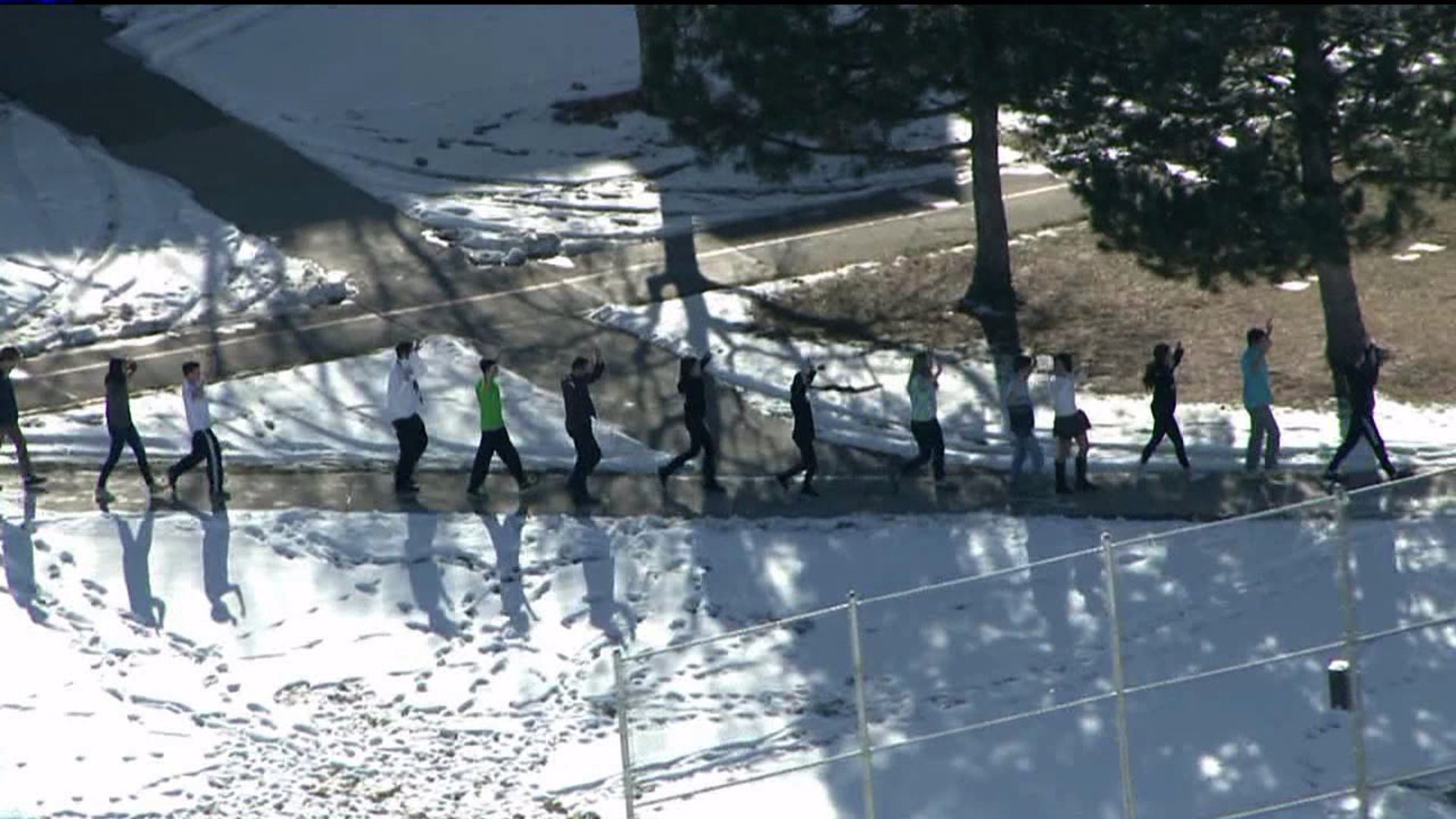 Students exit Arapahoe H.S. after shooting in Dec. 2013