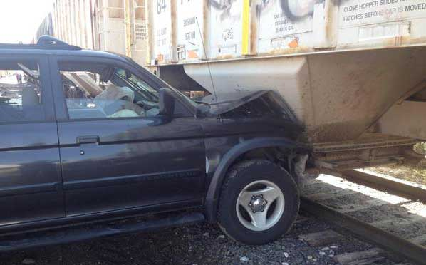 SUV hit 2 vehicles before crashing into train at 53rd and Fox in Adams County, Colo. Photo credit: Colorado State Patrol